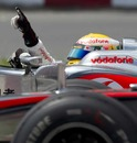 Lewis Hamilton celebrates alongside Jenson Button's McLaren