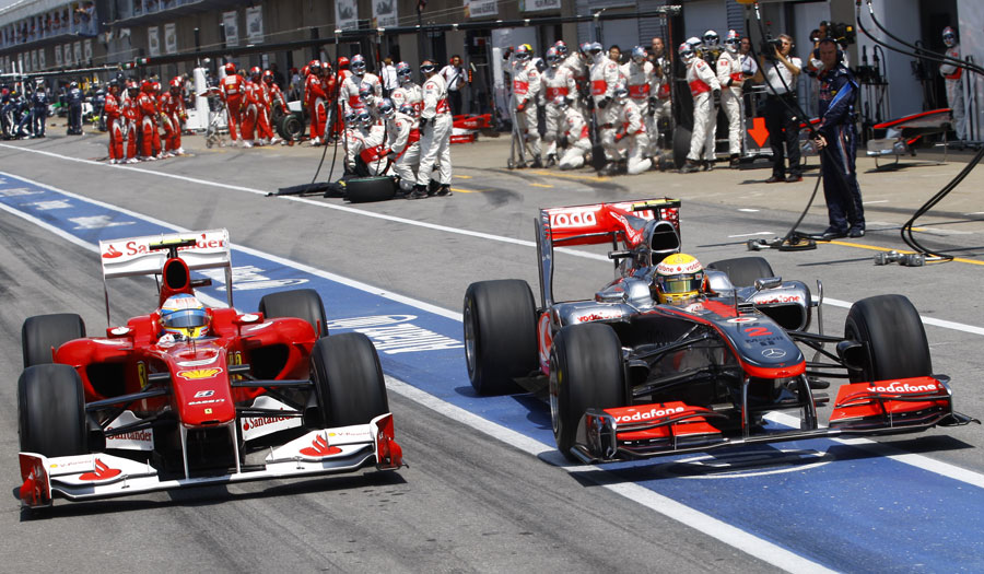 Lewis Hamilton and Fernando Alonso go wheel-to-wheel coming out the pits