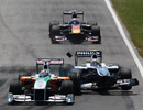Nico Hulkenberg crashes into the back of Adrian Sutil's Force India