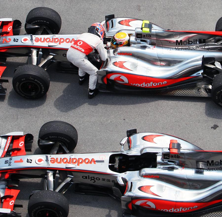 Lewis Hamilton and Jenson Button celebrate in parc ferme
