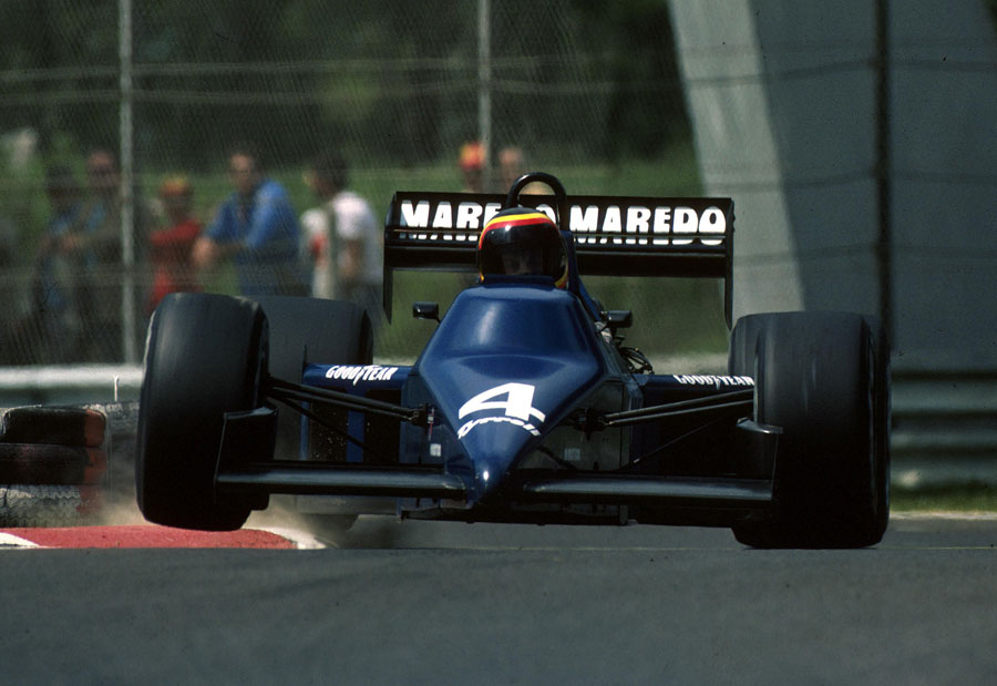 Stefan Bellof skips over the kerbs in his Tyrrell