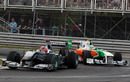 Michael Schumacher attempts to hold off Tonio Liuzzi
