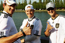 Adrian Sutil, Nico Rosberg and Michael Schumacher get into the spirit of the World Cup