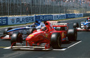 Race winner Michael Schumacher parks on the grid after the race is stopped due to Olivier Panis's accident