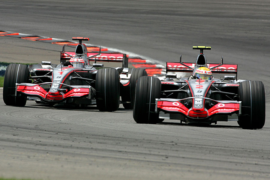 Lewis Hamilton leads Fernando Alonso through the chicane