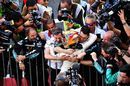 Lewis Hamilton cerebrates with Mercedes