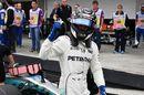 Pole sitter Valtteri Bottas celebrates in parc ferme