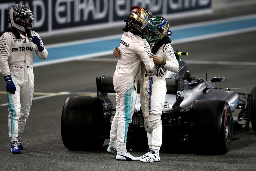 Lewis Hamilton congratulates and celebrates in parc ferme with Felipe Massa and race winner Valtteri Bottas