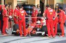 Sebastian Vettel returns to the pitbox