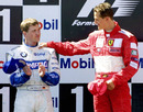 Michael Schumacher consoles brother Ralf on the podium after a closely fought French Grand Prix