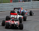 Mark Webber leads Lewis Hamilton and Fernando Alonso out of the hairpin
