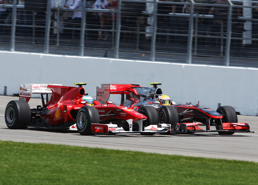 Fernando Alonso and Lewis Hamilton leave the pits side-by-side