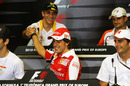 Vitaly Petrov shakes the hand of Fernando Alonso during Thursday's press conference