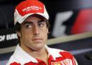 Fernando Alonso faces the press