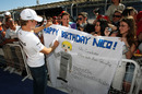 Nico Rosberg signs autographs for fans on his birthday