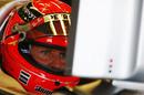 Michael Schumacher keeps an eye on the lap times