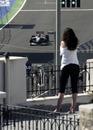 A spectator watches Michael Schumacher during practice