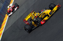 Renault's Robert Kubica leads Fernando Alonso's Ferrari