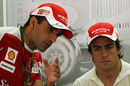Test driver Marc Gene talks to Fernando Alonso