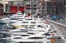 Felipe Massa speeds past boats in the harbour