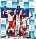 Pastor Maldonado (centre), Jules Bianchi (left) and Sam Bird (right) celebrate on the podium