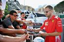 Sebastian Vettel signs autographs for fans