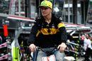 Nico Hulkenberg leaves the circuit on a push bike