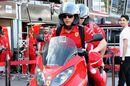 Kimi Raikkonen leaves the circuit on a motorbike