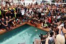 Race winner Daniel Ricciardo celebrates with a swan dive into the swimming pool