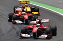 Fernando Alonso leads Felipe Massa and Robert Kubica