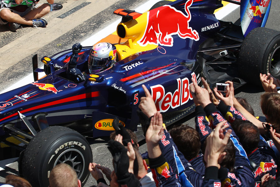 Sebastian Vettel celebrates with his Red Bull team