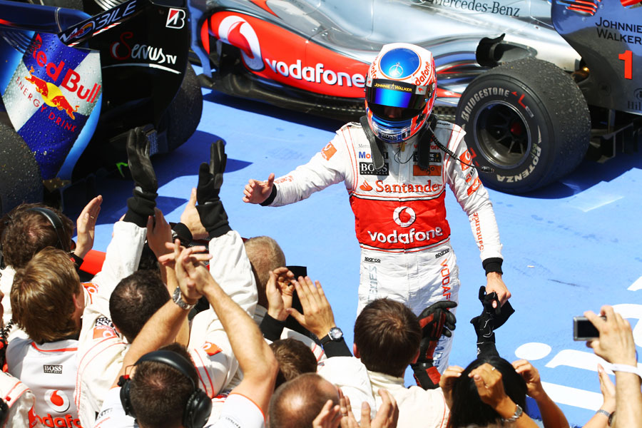 Jenson Button celebrates finishing third
