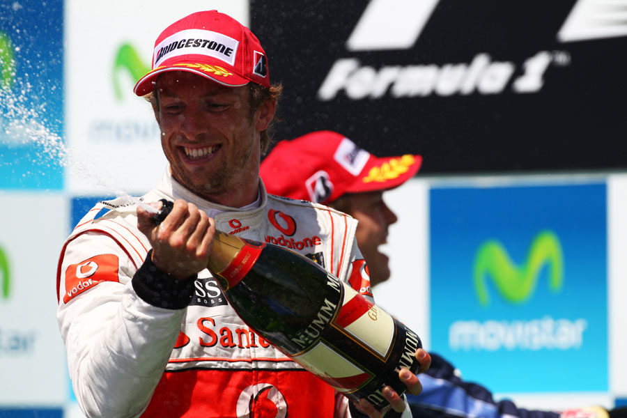 Jenson Button celebrates on the podium