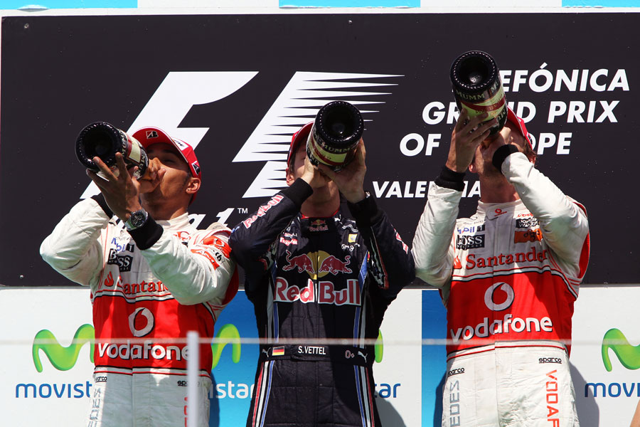 The top three drink champagne on the podium
