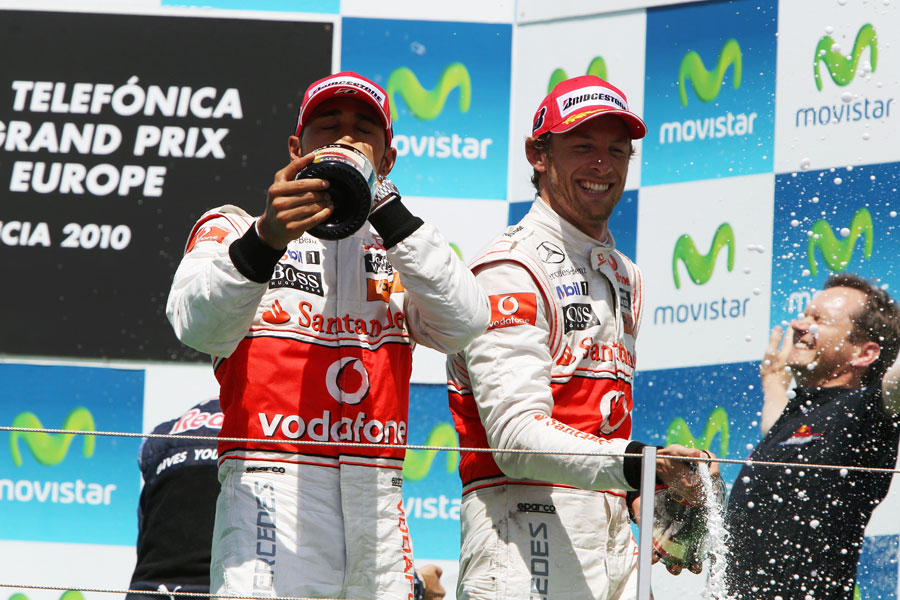 Lewis Hamilton and Jenson Button celebrate finishing second and third
