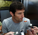 Mark Webber talks to the press after his crash