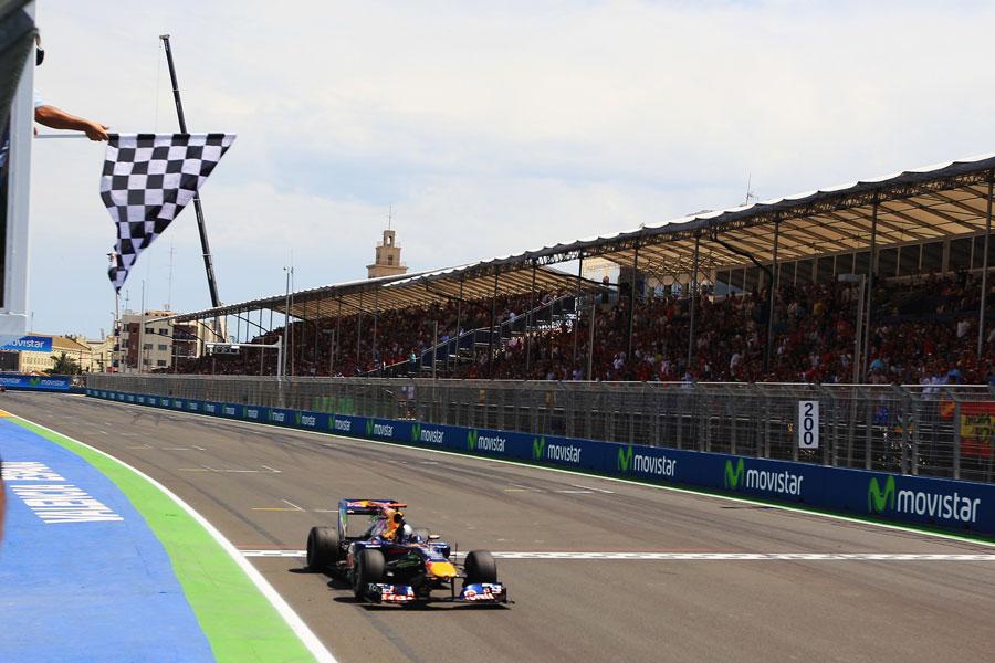 Sebastian Vettel takes the chequered flag