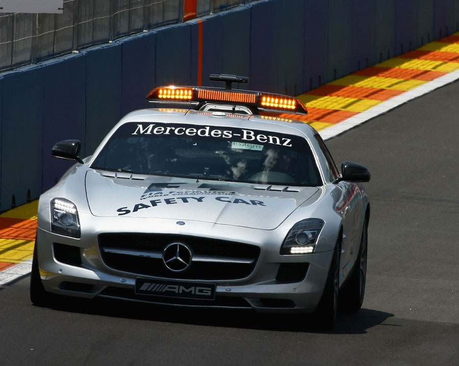 The safety car heads out on track after Mark Webber's accident