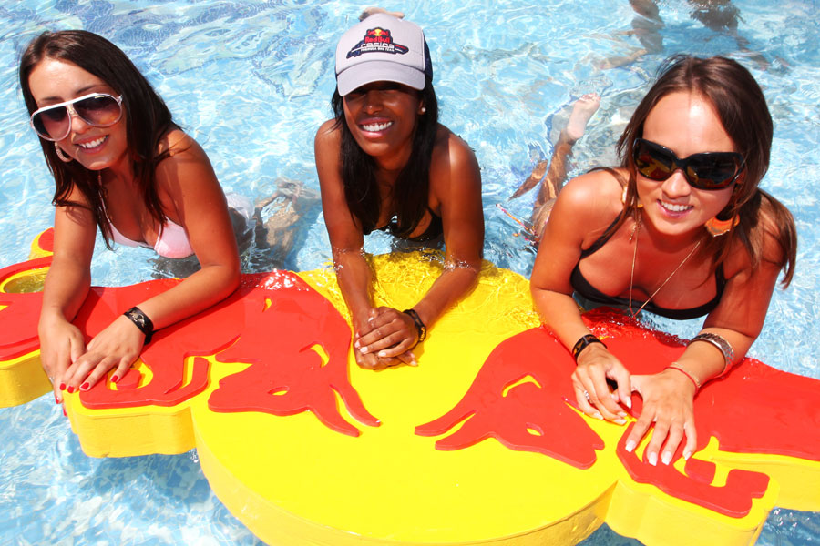 Girls relax in the Red Bull pool