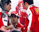 Fernando Alonso talks with Ferrari team boss Stefano Domenicali