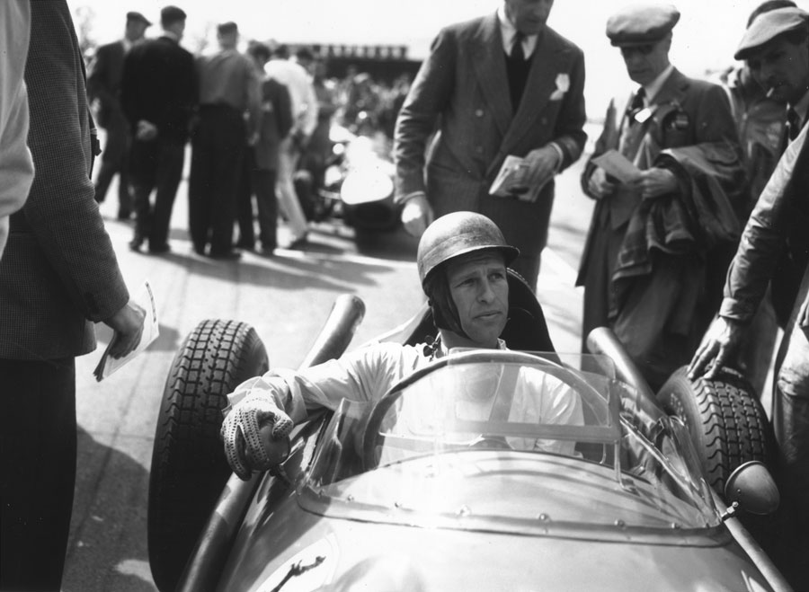 Peter Collins at the wheel before a race at Silverstone