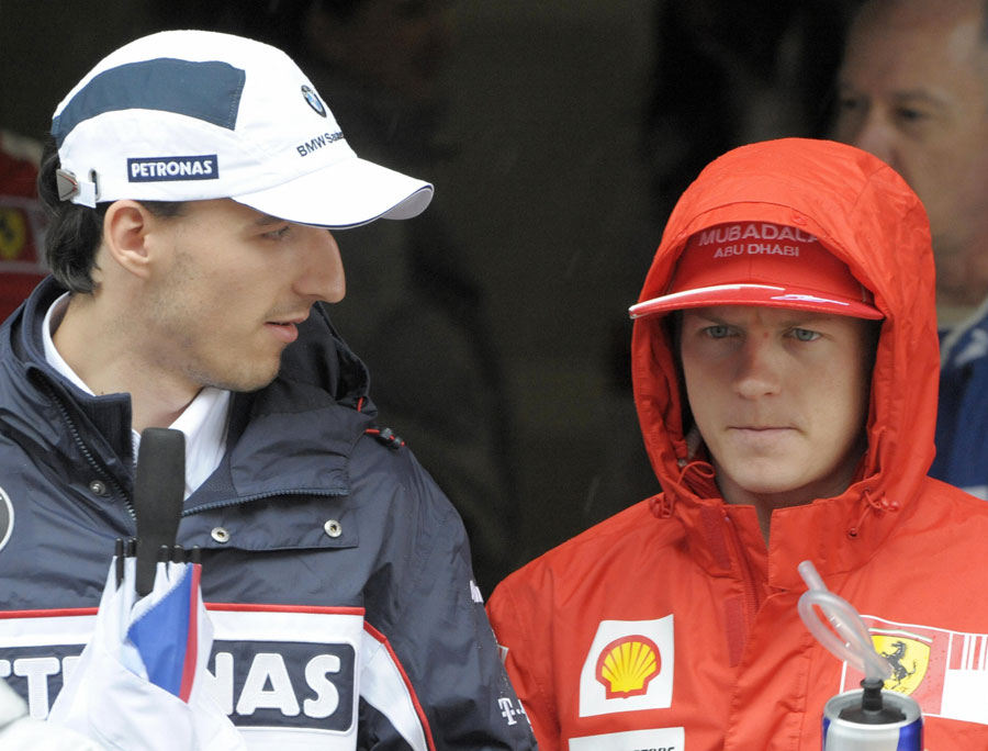 Kimi Raikkonen chats to Robert Kubica before the drivers' parade for the Chinese Grand Prix