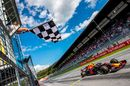 Race winner Max Verstappen takes the chequered flag