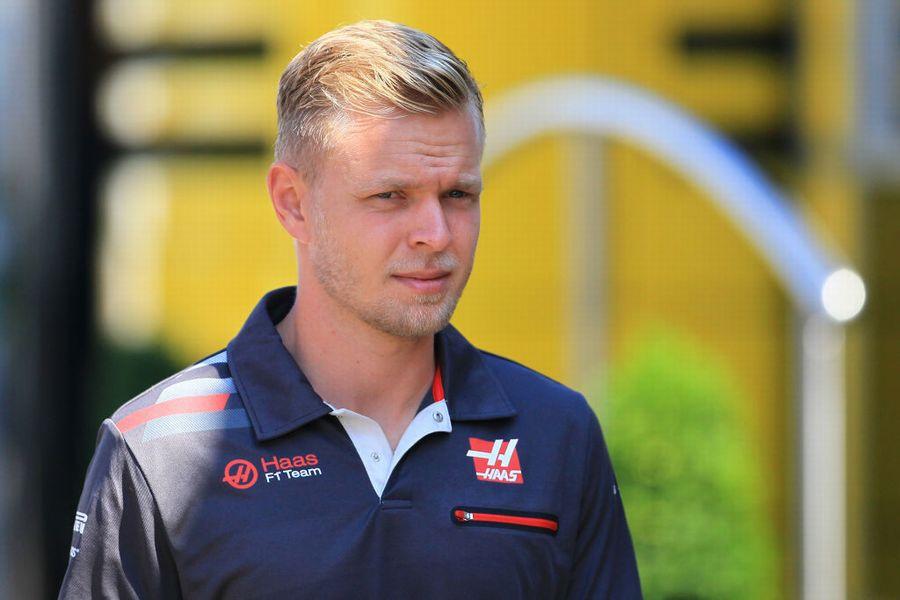 Kevin Magnussen walks through the paddock