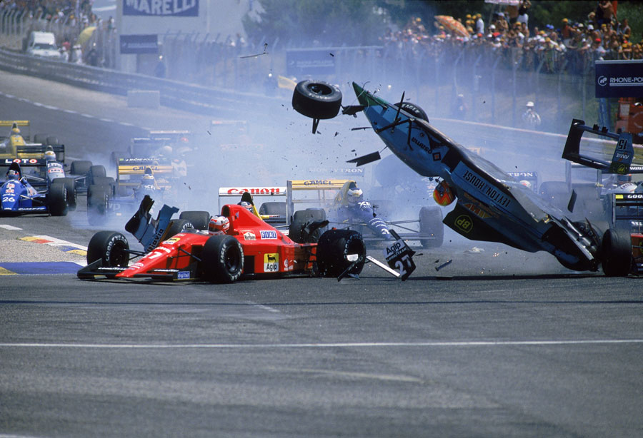 Mauricio Gugelmin lands in the middle of the first corner after hitting the back of Thierry Boutsen's car