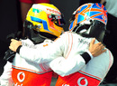 Jenson Button congratulates Lewis Hamilton on his victory