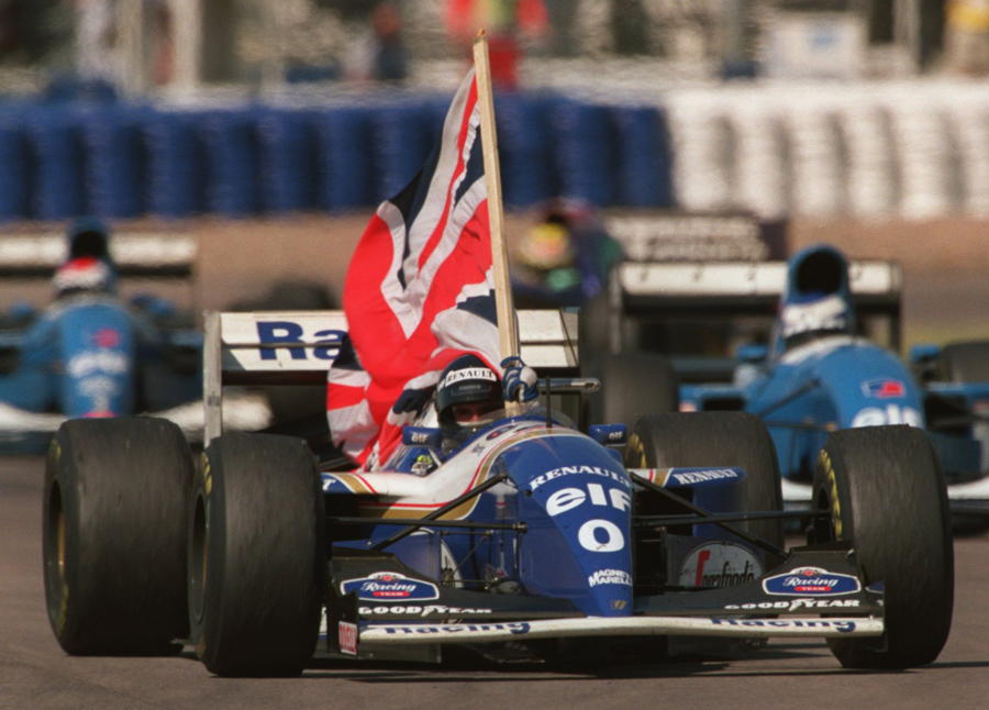 Damon Hill celebrates winning the 1994 British Grand Prix