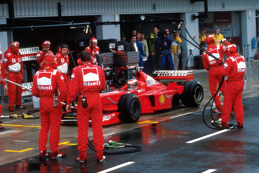 Michael Schumacher makes his stop and go penalty on the last lap, winning the race in the pitlane