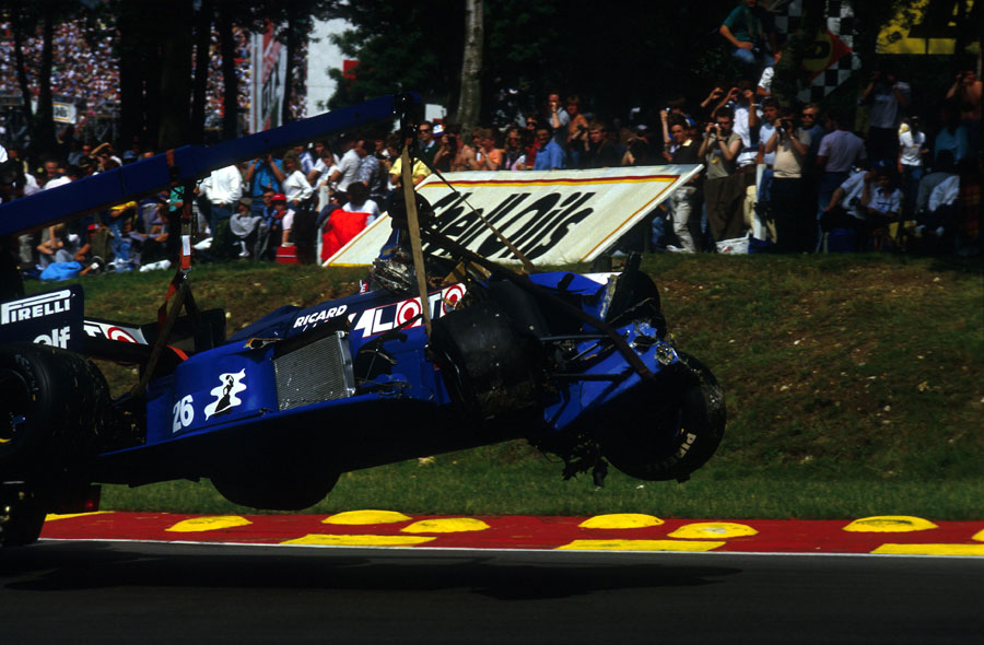 The Ligier of Jacques Laffite is carried away after a start line crash that ended his career