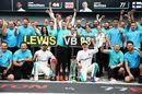 Race winner Lewis Hamilton celebrates with Valtteri Bottas
